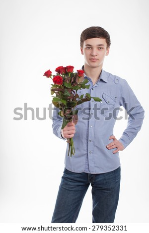 Male and Man with flowers on a white background isolated.Teenager with red roses.Bouquet of roses.