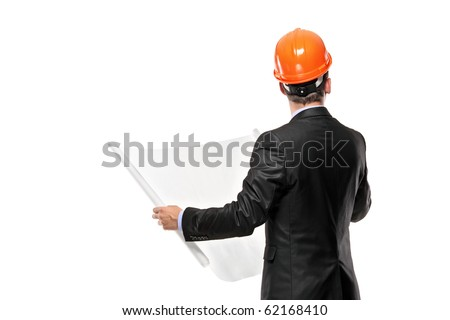 Male architect looking at blueprints against white background - stock photo