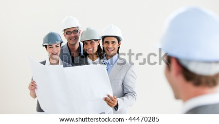 Male architect looking back at his colleagues against a white background - stock photo