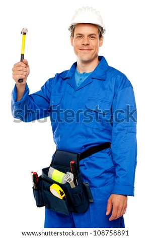Male architect team guy holding hammer with tool box wrapped around his waist - stock photo