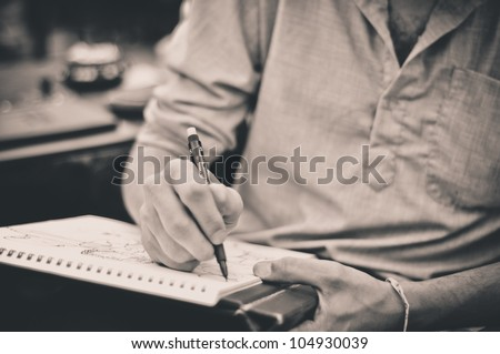 Male artist drawing - stock photo