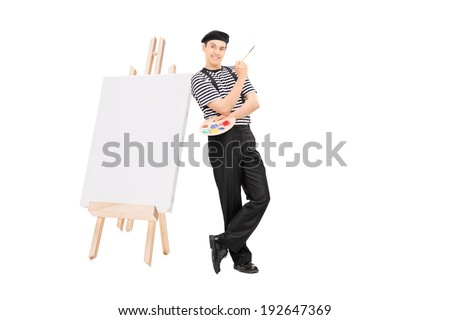 Male artist leaning on an easel and holding a paintbrush isolated on white background - stock photo
