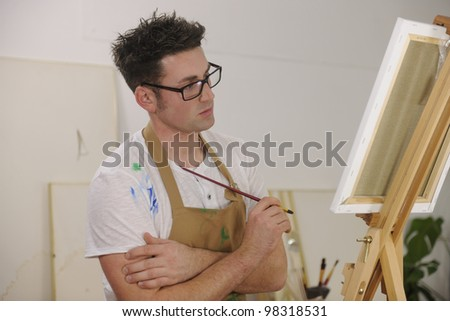 male artist painting female model at art studio - stock photo