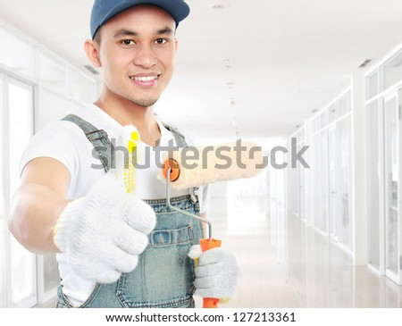 male asian Painter showing thumb up gesture - stock photo