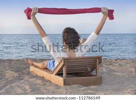 Male at beach against sea and blue sky - stock photo