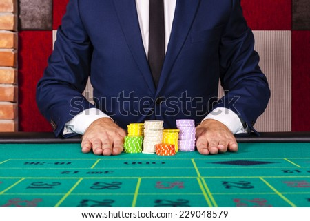 Male at casino - stock photo