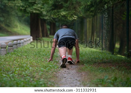 Male Athlete Runner In Starting Line Ready For Running And Sprint - Fitness Healthy Lifestyle Concept - stock photo