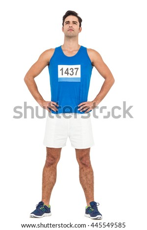 Male athlete standing with hands on hip on isolated white background - stock photo