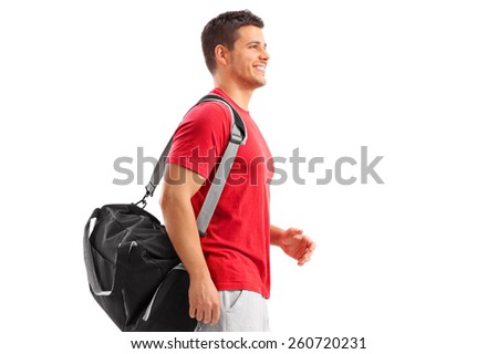 Male athlete walking with a sport bag isolated on white background