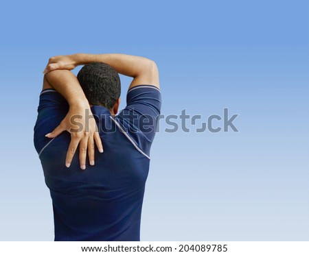 male athlete warming up doing stretch - stock photo