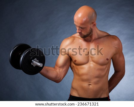 male athlete with dumbbell during a workout - stock photo