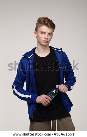 male athlete with water bottle