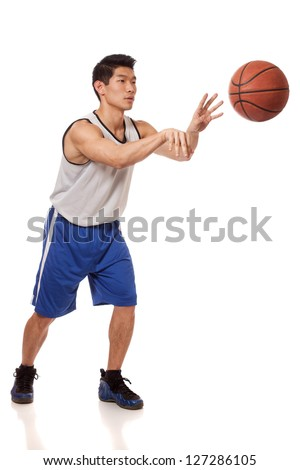 Male basketball player. Studio shot over white. - stock photo