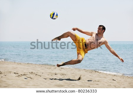 male beach volleyball game player jump on hot sand - stock photo