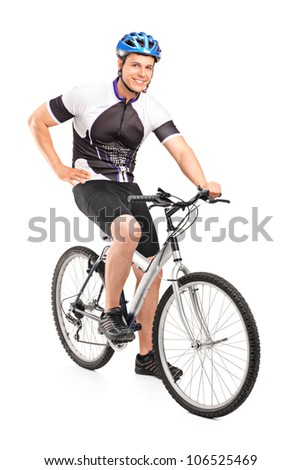 Male biker with helmet posing on a bike isolated against white background