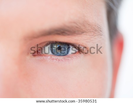 Male blue eye in close-up as symbol concept of successful business vision - stock photo