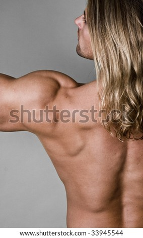 Something Long haired female body builder