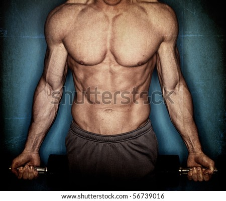 male body builder on textured background - stock photo