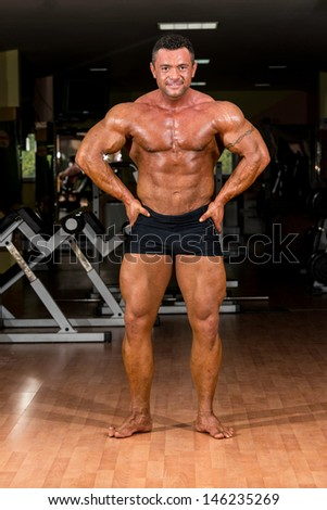 male body builder showing his body - stock photo