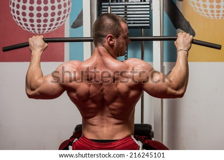 Male Bodybuilder Doing Heavy Weight Exercise For Back - stock photo