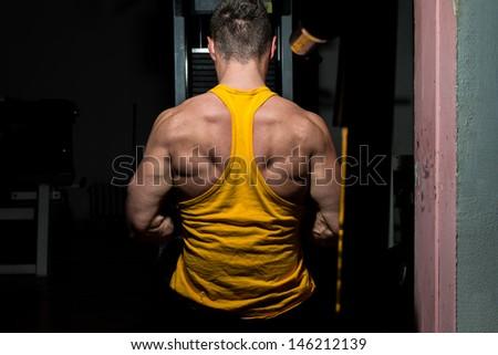 male bodybuilder flexing his back - stock photo
