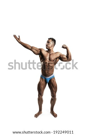 Male bodybuilder posing on white background - stock photo