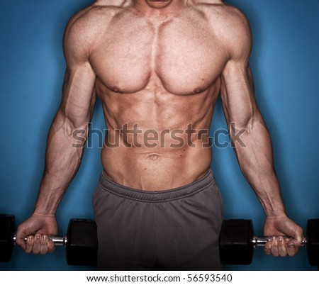 Male Bodybuilder working out - stock photo