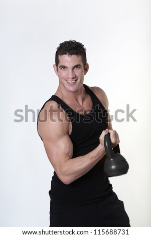 male bodybuilding doing a work out  lifting kettlebell - stock photo