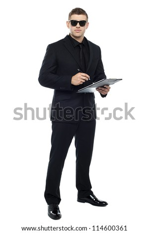 Male bouncer holding clipboard isolated against white background - stock photo