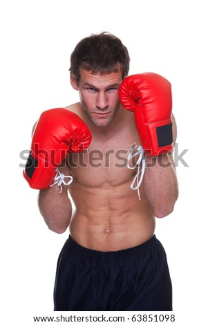 Male boxer in a defensive stance isolated on white background - stock photo