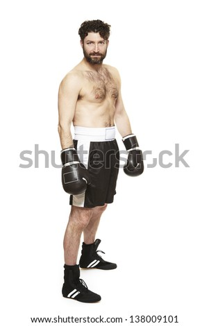 Male boxer in boxing stance ready to fight isolated on white background - stock photo