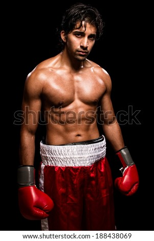 Male boxer in red. Studio shot over black. - stock photo