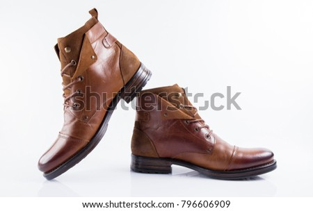 Male brown leather boot on white background, isolated product, comfortable footwear.