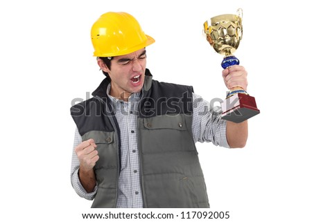 Male builder holding trophy - stock photo