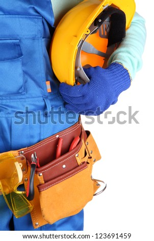 Male builder in blue overalls with yellow helmet  isolated on white - stock photo