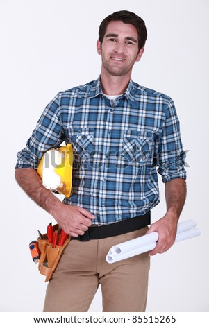 Male builder with plans - stock photo