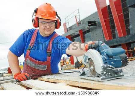 Male builder working with power tool circular saw machine cutting plastic parts at construction site - stock photo
