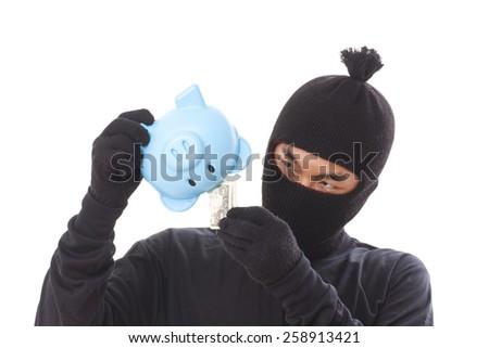 male burglar with piggy bank - stock photo