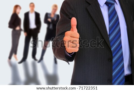 Male Business leader standing in front of his team - stock photo