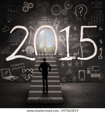 Male business person standing on stairway in front of a future door 2015 - stock photo
