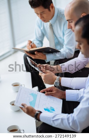 Male business team working in the office, selective focus