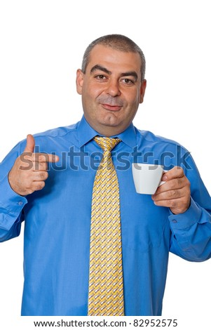 Male businessman in a blue shirt and tie, drinking coffee from a white coffee cup gesturing approvingly smiling isolated on white background