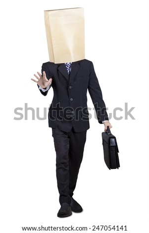 Male businessman walking with blindfold in the studio, isolated on white background - stock photo