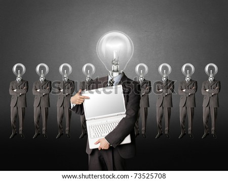 male businessman with lamp-head and laptop have got an idea - stock photo