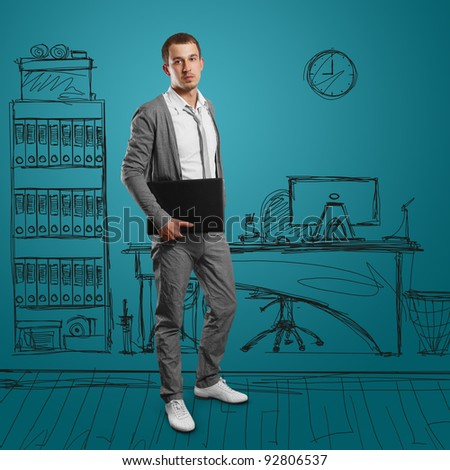 male businessman with laptop in his hands, looking on camera - stock photo
