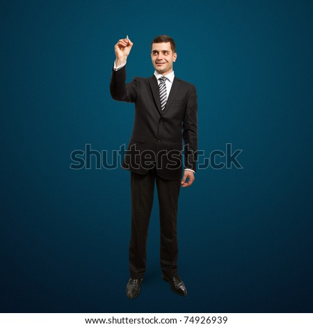male businessman with marker writing something on glass write board - stock photo