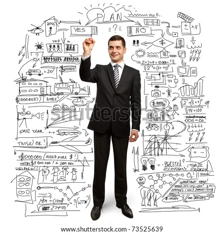 male businessman with marker writing something on glass writeboard