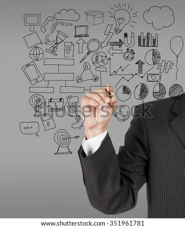 male businessman with marker writting something  - stock photo