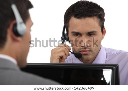 Male call-center workers - stock photo