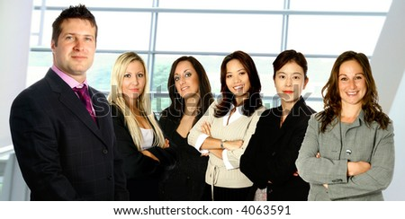 Male caucasian businessman leading a team of business women from diverse background made up of a caucasian, a mediterranean, an Asian and a Japanese woman,  isolated on white.